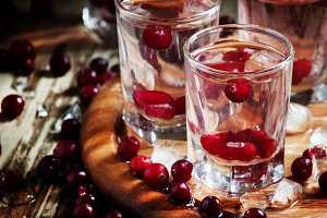 Cold cranberry vodka with fresh berr