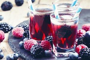 Ice berry tea with raspberries, blac
