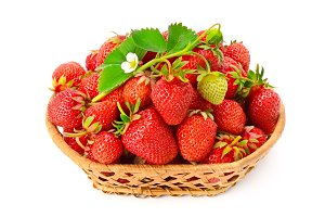 Ripe strawberries with flower in bas