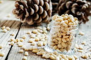 Peeled cedar nuts in a jar on the ol