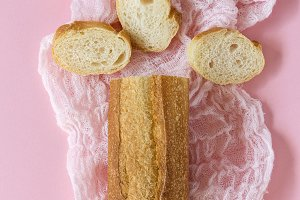 Fresh bread with pink background.
