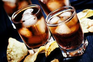 Cold Cola with ice in glasses and po