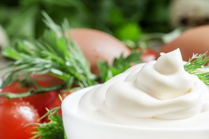 Homemade mayonnaise sauce in a white