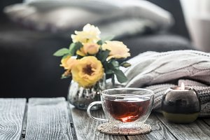 cup of tea with flowers in an interi