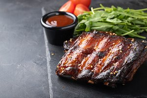 Closeup of pork ribs grilled with BB