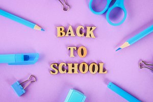 School supplies on violet background