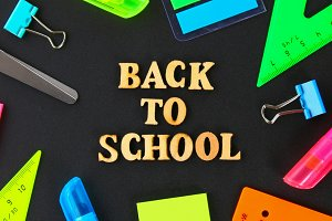 School supplies on blackboard backgr