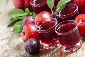 Fresh fruit juice of red plums and p