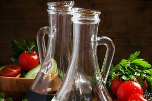 Fresh olive oil in glass carafe with