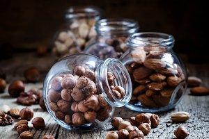 Hazelnut in a glass jar, dark toned