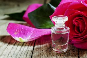 Rose essential oil in a small bottle