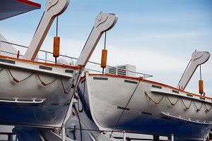 Lifeboats close-up against the sky