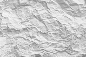 Crumpled paper. White pattern textur
