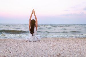 woman practices yoga and meditates i
