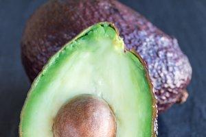 Avocado on a dark slate background,