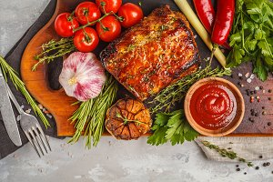 Baked pork with thyme, rosemary