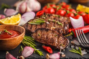 Grilled beef steaks with spices