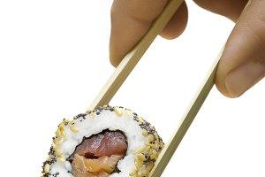 closeup holding sushi