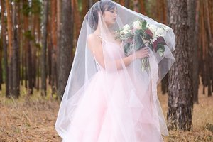 Gorgeous bride in pink dress