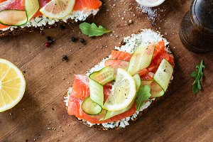 Sandwich with salmon on wood