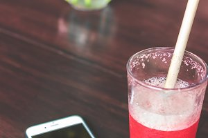Raspberry lemonade with smartphone