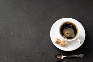 Cup of coffee on black concrete