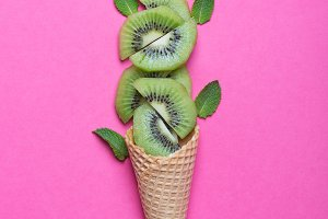 Kiwi with ice cream cones on stone b