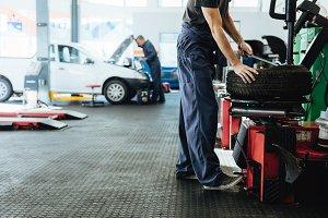 Car repair shop with mechanics