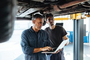 Technicians working in auto service