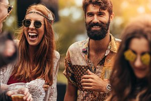 Happy young hippie friends