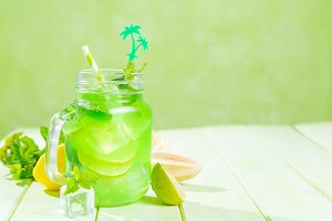 Summer lemonade on wood background