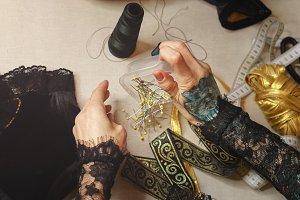 Girl sews a dress