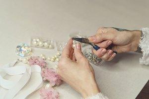 Girl is making jewelry