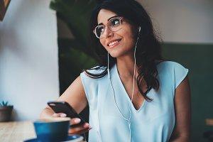 Cute woman enjoying music