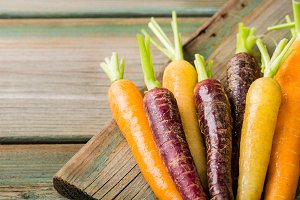 Fresh raw colorful carrots roots