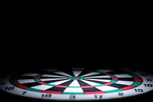abstract dartboard on dark backgroun