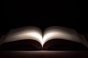 abstract open book on dark backgroun