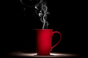 red coffee cup with smoke on black b
