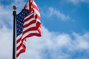 American Flag Waving Blue Sky