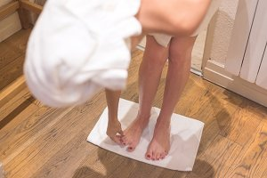 Female legs in bath towel.