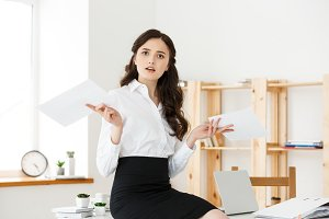 Shocked young business woman