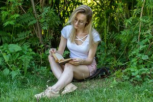 Young attractive woman reading book