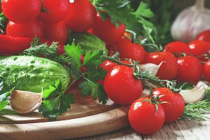 Fresh cherry tomatoes with spring ve