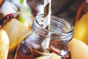 Cold pear juice with a straw, black
