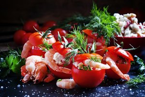 Tomatoes stuffed with shrimp and veg