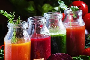 Vegetable smoothie in small bottles,