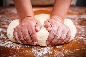 Female hands preparing dough