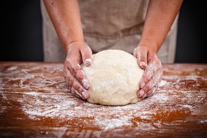Baker shaping bread dough