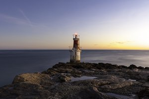 lonely lighthouse at sunrise