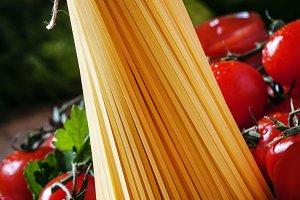 Spaghetti and tomato, vertical image
